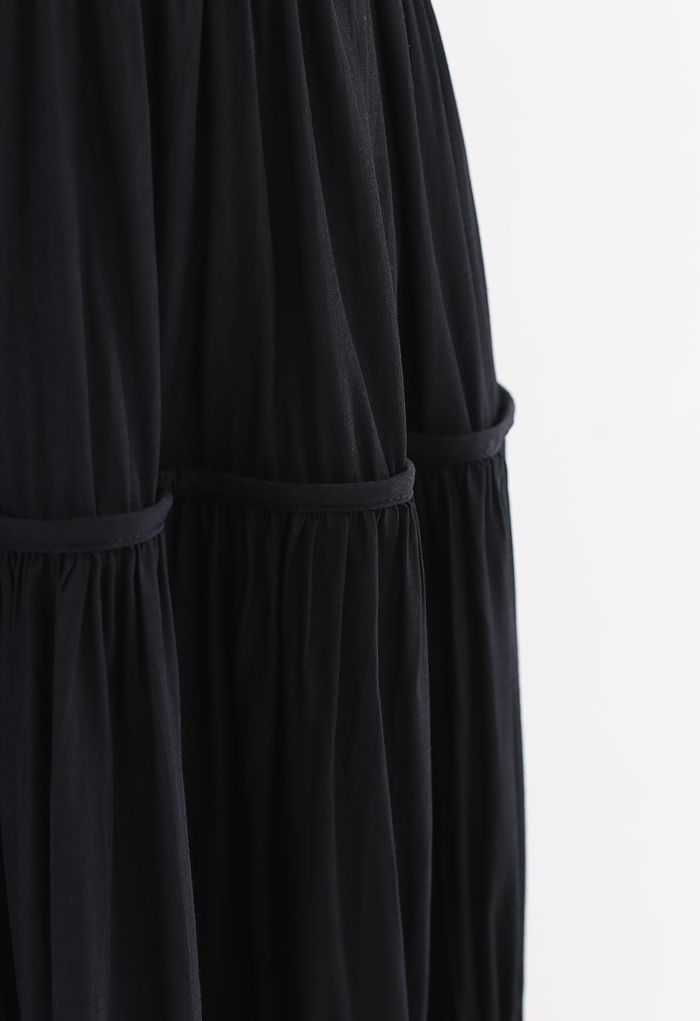 Swing Pleated Midi Skirt in Black