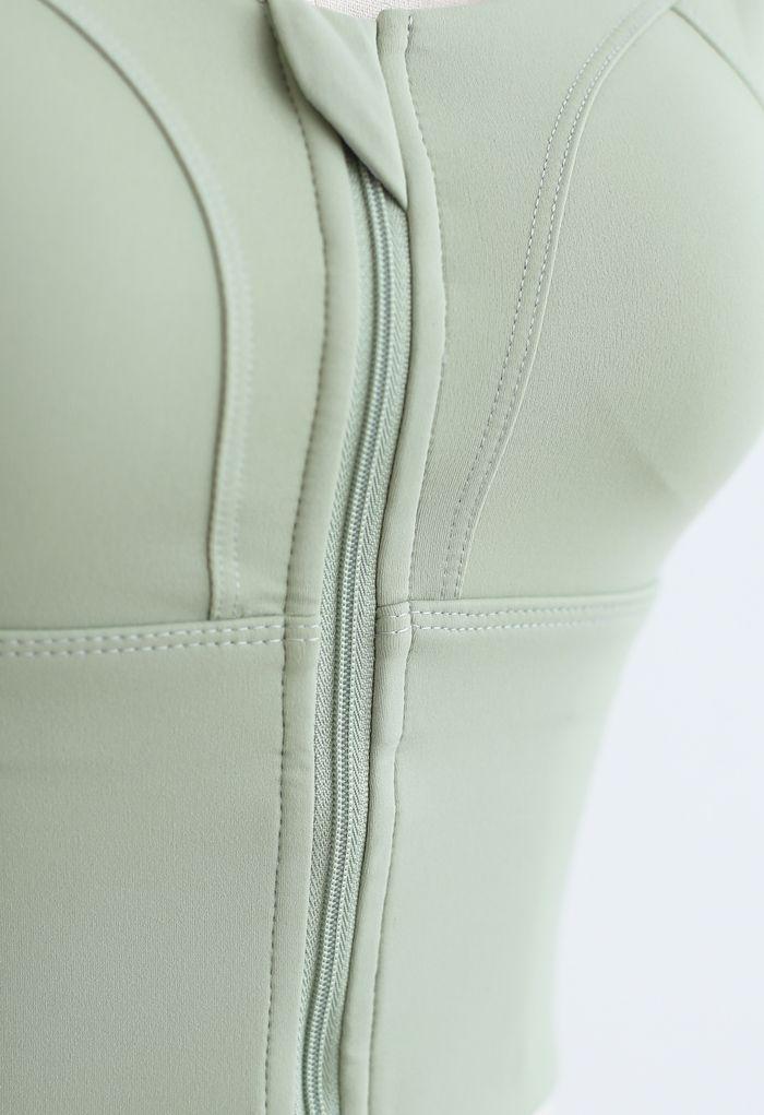Cross Back Zipper Front Panelled Sports Bra in Pistachio