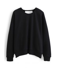 Crisscross Open Back Sweatshirt in Black