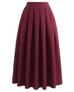 Carnation Embossed Satin Pleated Midi Skirt in Burgundy